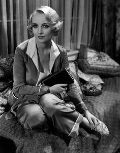 Beautiful blonde actress Carole Lombard sporting a chic silk lounge wear look during the 1930s.