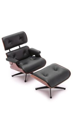 miniature eames lounge chair with tattoed man youngandtatted