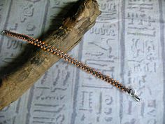 Friendship bracelet in gray and peach. by EgyptianInspirations