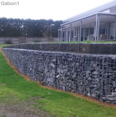 curved gabion wall with basalt stone capping http://www.gabion1.co.nz