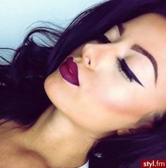 Loving the dark lips and winged eyeliner.