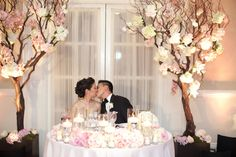 Bride and Groom at Sweetheart Table | photography by http://www.sarahkchen.com Stunning trees - bringing the outdoors in.