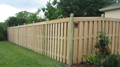 Semi-privacy capped wood fence design by Mossy Oak Fence.