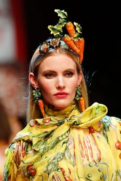 Dolce & Gabbana KILLED the jewellery game at their SS18 show with incredible pieces inspired by a whole host of different items. We're talking cars, cherubs, vegetables, fruits...
