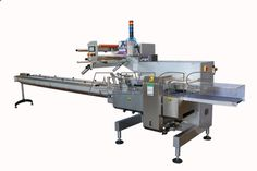 The flow-pack machine for film width 650 mm. The horizonthal flowpack packaging machines are machinery for packaging of products, which make their  versatility distinguishing mark, as they can be used in a wide range of fields. #flowpackmachines #flowpack #flowwrap #packaging #wrappingmachines #packagingmachines #amgs