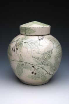 Blackberry Raku Ceramic Cremation Urn. Imagery is created using real blackberry leaves and berries, which are fired onto the raku memorial urn. Made by hand in the USA.