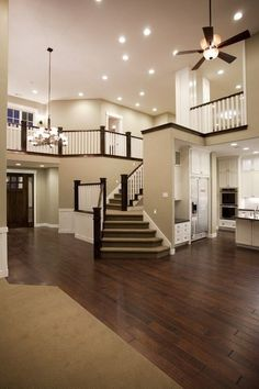 staircase that does NOT walk you out the front door!love the openness of the house. I think I will design my future house like this House Design, Future House, House, Traditional Staircase, House Goals, Custom Homes, House Plans, House Styles, New Homes