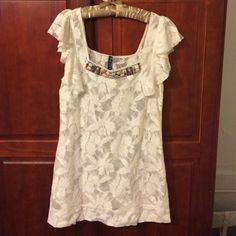 Free people lace jeweled neck shift dress Adorable lace dress with jeweled neckline. Never worn. Flutter sleeve. Would make a super cute beach coverup dress or could be worn with a slip as it is see through. Free People Dresses