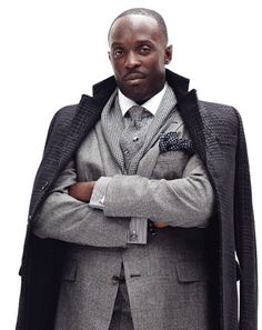 OMG, the ultimate layered look...let's start with the cufflinks, pocket square, knit tie with a diagonal placed stick pin......13. Chalky White (Michael Kenneth Williams), Boardwalk Empire