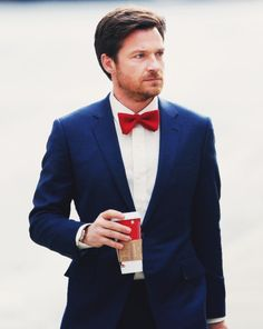 red bowtie, navy blue suit groom's outfit