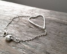 Hand shaped & hammered fine silver (.999% pure silver) heart bracelet on a silver filled chain. Connected by a silver filled lobster clasp with