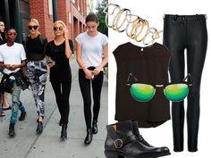 È la divisa d'ordinanza degli addetti ai lavori: jeans aderenti, T-shirt larga, stivaletti e occhiali scuri. Tutto nero ovviamente. Sembra un completo