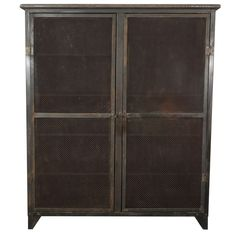 Industrial Armoire  France  19th Century  Vintage armoire made of metal and cornice  with two doors of heavy mesh screen and   various built in shelves perfect for storage  or display.