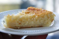 Impossible Coconut Pie  1/2 cup sugar 1/2 cup Bisquick (make your own! see above) 4 eggs 1/4 cup butter, melted 2 cup milk 1/2 tsp. vanilla 1 cup shredded coconut  In a medium bowl, blend all the ingredients together by hand or on low speed for 30 seconds. Pour into a 10-inch pie plate that has been buttered or sprayed with nonstick spray. Bake at 350F. for 50 minutes, or until golden and set.