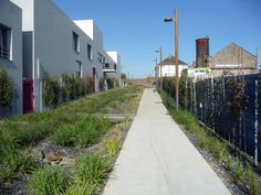 45-Between-an-old-farm-and-the-new-dwellings,-the-alley-and-the-ditch-collecting-the-rain-water « Landscape Architecture Works | Landezine