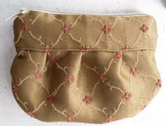 http://www.etsy.com/listing/93693327/fabric-zipper-pouch