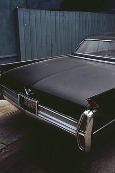 Lucian's solid-gold Cadillac convertible had vestigial tail fins, just like these.