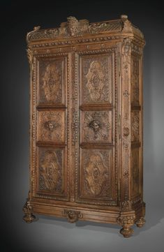 A FINE CARVED OAK CUPBOARD, PARTLY LOUIS XIV, ADAPTED DURING 19TH CENTURY ( This piece is super close up.. to see the fine detail click on large image Sothebys site will come up then click on the magnifying glass AW)