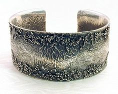 Cuff - James Morton. Sterling silver with textures and patina.