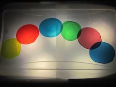 She melted down plastic cups in the oven and used them as color discs on the light box!
