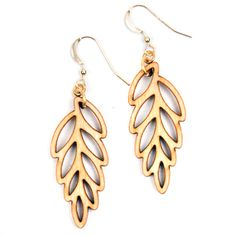 One of our best selling items! Birch leaf earrings now on SALE for $19. Usually $35. Laser cut leaf earrings in birch or walnut wood. These light,