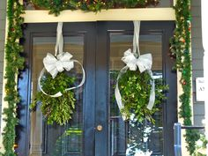 For Holiday Curb Appeal, try swags of greenery on your front door, rather than the standard #wreath #holiday #christmas | From The Home Depot's Apron blog Holiday Style Challenge series and Carrie of Hazardous Design