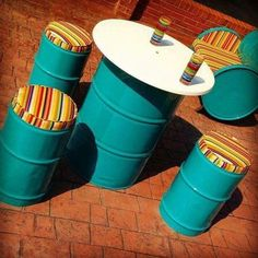 Use recycled oil barrels to create a bistro-style outdoor dining or entertaining area that is durable and won't break the bank.