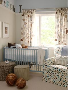 nurseries - ICI Dulux - Cloud Nine - white brown blue leaf drapes brown gray round ottomans white brown blue polka dot glider striped gray lumbar pillow picture ledge blue gray tan walls