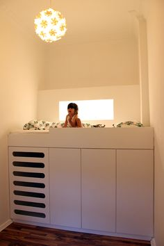 loft bed, super space saving design. love the light niche.