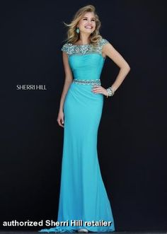 Sherri Hill - 32026 available at Miss Priss.  This turquoise, tiffany blue gown with a jersey, fitted skirt and high beaded neckline, is gorgeous for prom, pageants, and formal events!