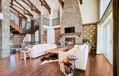 Living Room - open concept + ceiling beams + gorgeous fireplace