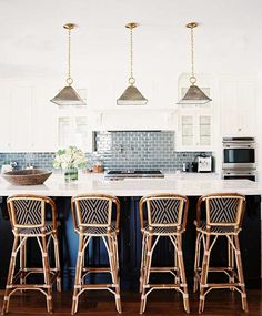 two-tone kitchen; blue-gray backsplash; pendants & barstools