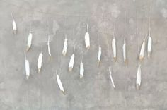 Glam DIY Glitter Dipped Feather Garland   With pheasant feathers?