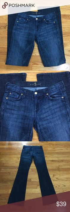"""7Fam Flare jeans in size 28 These classic 7 For All Mankind Flare blue jeans in a medium-dark wash feature five pocket styling and light whiskering.  Inseam is 33.5"""" and rise is just short of 8"""".  In excellent used condition, them hems are completely free of frays or wear. 7 For All Mankind Jeans Flare & Wide Leg"""
