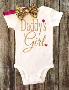 Daddys Girl Bodysuit, Baby Girl Daddys Girl Bodysuit, Girls Shirt, Baby Girl Clothes, Bodysuit, Bodysuit For Baby Girls, Daddy Shirts ******BODYSUIT ONLY BOW NOT INCLUDED**** HEADBAND & BOW IN SELECTION BAR Our sparkle Bodysuits are a huge hit! Great baby shower gifts & are great for photo shoots! Youre little girl will be the sparkling center of attention. Be sure to wash inside out. Hang dry or dry inside out on low heat to prevent cracking. That is to protect the vinyl from being…