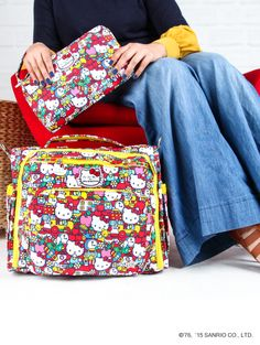 Ju-Ju-Be's cute and colorful Hello Kitty Tick Tock range of bags, diaper bags and kid wrangling accessories.