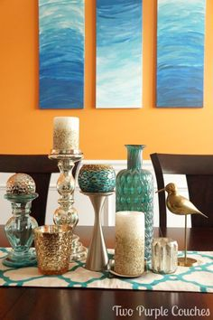 Bold orange and teal dining room decor and accessories