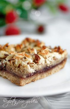 Party worthy gluten-free vegan raspberry coconut almond cookie bars.