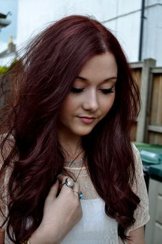 Dark cherry red hair.
