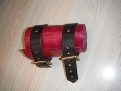 Overstrap type vambrace, in red/pink with brass buckles. £17.50
