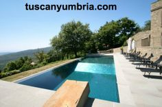 The infinity edge pool at luxury holiday rental Villa Padrone is lined with mosaic tiles that reflect the sunlight. This villa is on the Tuscany Umbria border in central Italy http://www.tuscanyumbria.com/italian-villas/small-rentals/padrone/