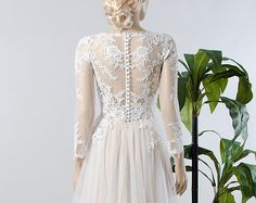 Lace and tulle Long Sleeve Wedding Dress by LikhomanovaCouture