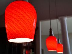 Hanging red glass lights in kitchen