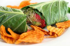 The Collard Wrap:  YOU NEED:  8 large collard leaves  Veggies of choice (avocado, sliced tomatoes, cucumbers, sprouts, etc.) and even quinoa or sunflower seeds are nice in there too!  Chickpea beet spread  For Chickpea beet spread:  10 oz soaked or canned garbanzo beans  1/2 a med-sized beet, peeled  2 carrots, peeled  Juice from one lemon  2 tablespoons tahini  3 teaspoons olive oil  Salt to taste  Cracked black pepper to taste  1-2 tablespoons agave nectar  A few sprigs of fresh parsley  1...