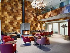 When Kjellgren Kaminsky Architecture were designing the interiors of the Swedish hotel Öijared, they decided to use a variety of wood panels to cover the walls in the lounge area of the hotel.