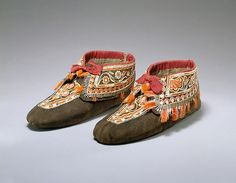 Pair of Moccasins Date: 1790–1815 Geography: Canada, Quebec Culture: Huron Medium: Native-tanned and dyed skin, silk, quill, deer and moosehair, metal Dimensions: H. 4 1/2 x L.10 1/2 in. (11.4 x 26.7 cm) Classification: Hide-Costumes Credit Line: Ralph T. Coe Collection, Gift of Ralph T. Coe Foundation for the Arts, 2011 Accession Number: 201