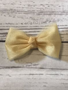 A personal favorite from my Etsy shop https://www.etsy.com/listing/548899628/gold-hair-bow-tulle-bows-christmas