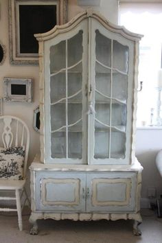 Armoire cabinet in annie sloan `duck egg` mixed with `old white` and details and interior in `old ochre` with light and dark wax and distressing. www.fifichic.co.uk