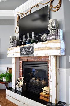 Halloween Mantle Ideas- I have a nice rope, could easily do this!