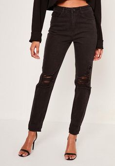 Get fierce in our high rise mom jeans. Busted knee detail for an extra urban edge
